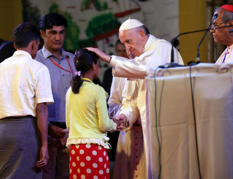 Pope Francis blesses a Rohingya girl on Dec. 1. Photo by Mohammad Ponir Hossain/Reuters