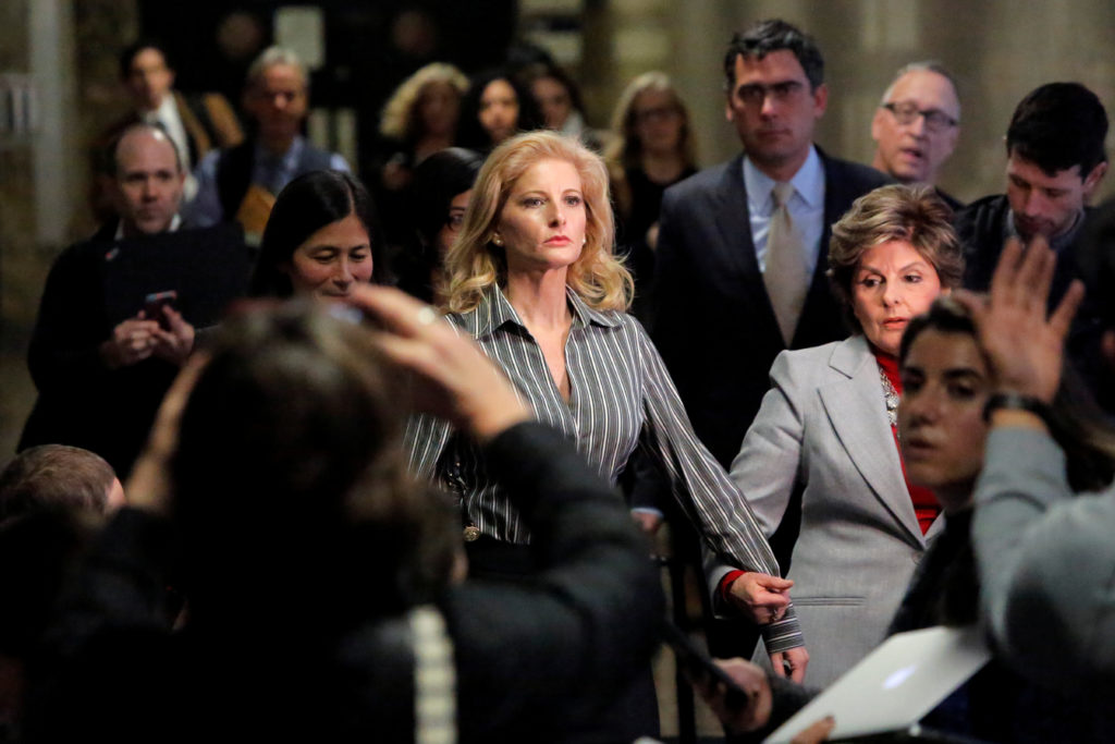 Summer Zervos, a former contestant on The Apprentice, leaves New York State Supreme Court with attorney Gloria Allred (R) after a hearing on the defamation case against U.S. President Donald Trump in Manhattan, New York City, U.S., December 5, 2017. REUTERS/Andrew Kelly - RC1D0346BE00