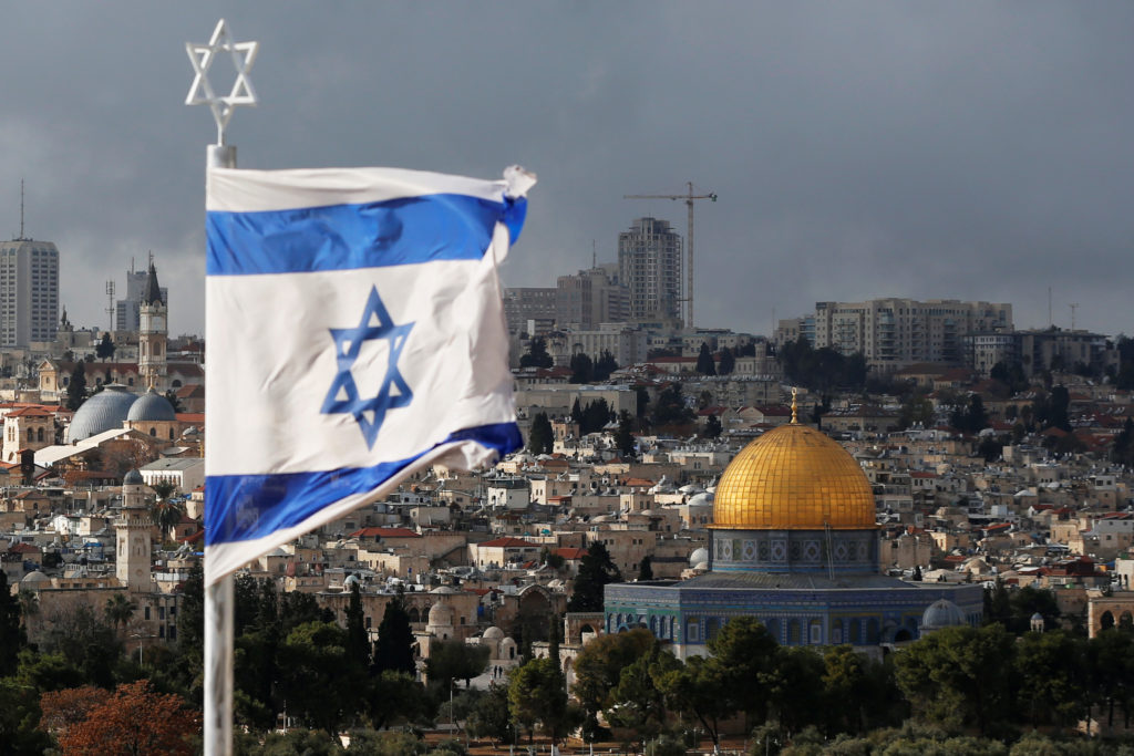 An Israeli flag is seen near the Dome of the Rock, located in Jerusalem's Old City on the compound known to Muslims as Noble Sanctuary and to Jews as Temple Mount on Dec. 6. Photo by Ammar Awad/Reuters