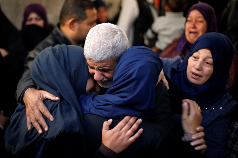 Relatives of a Palestinian man, who was shot dead during clashes with Israeli troops on Friday, mourn during his funeral in Khan Younis in the southern Gaza Strip