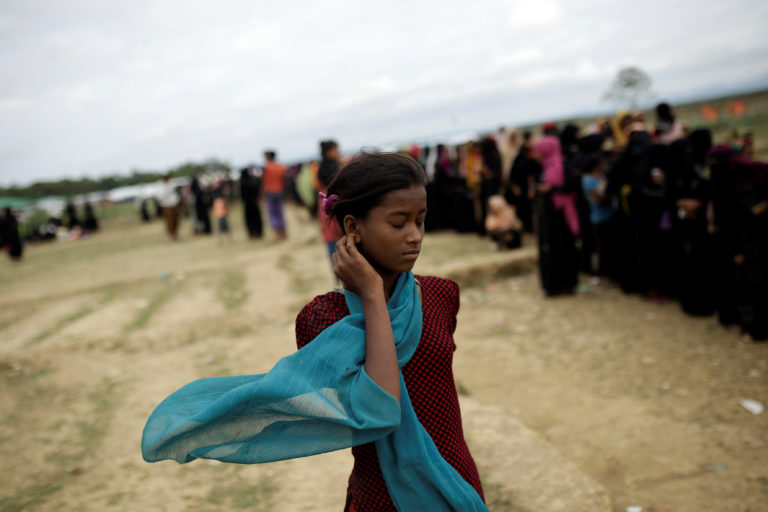 A Rohingya refugee makes her way to a distribution area of the Nayapara camp near Cox's Bazar, Bangladesh, on Dec. 10. Photo by Alkis Konstantinidis/Reuters