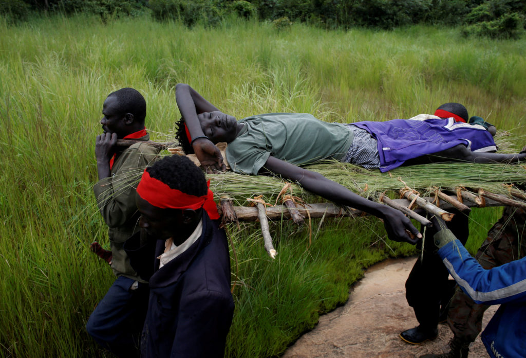Rebels carry an injured fighter after an assault on government soldiers, on the road between Kaya and Yondu, in South Sudan on Aug. 26. Photo by Goran Tomasevic/Reuters