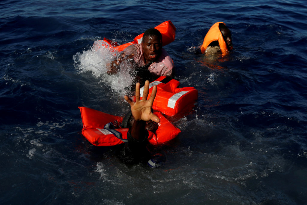 Migrants try to stay afloat after they fell off their rubber boat during a rescue operation by the Malta-based NGO Migrant Offshore Aid Station ship in the central Mediterranean Sea on April 14. All 134 sub-Saharan migrants, who were coming from Libya, survived. Photo by Darrin Zammit Lupi/Reuters