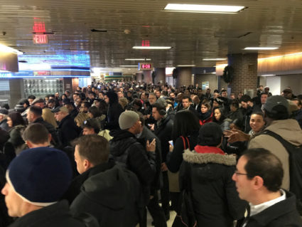 Commuters exit the New York Port Authority in New York City, U.S. December 11, 2017 after reports of an explosion. REUTERS/Edward Tobin