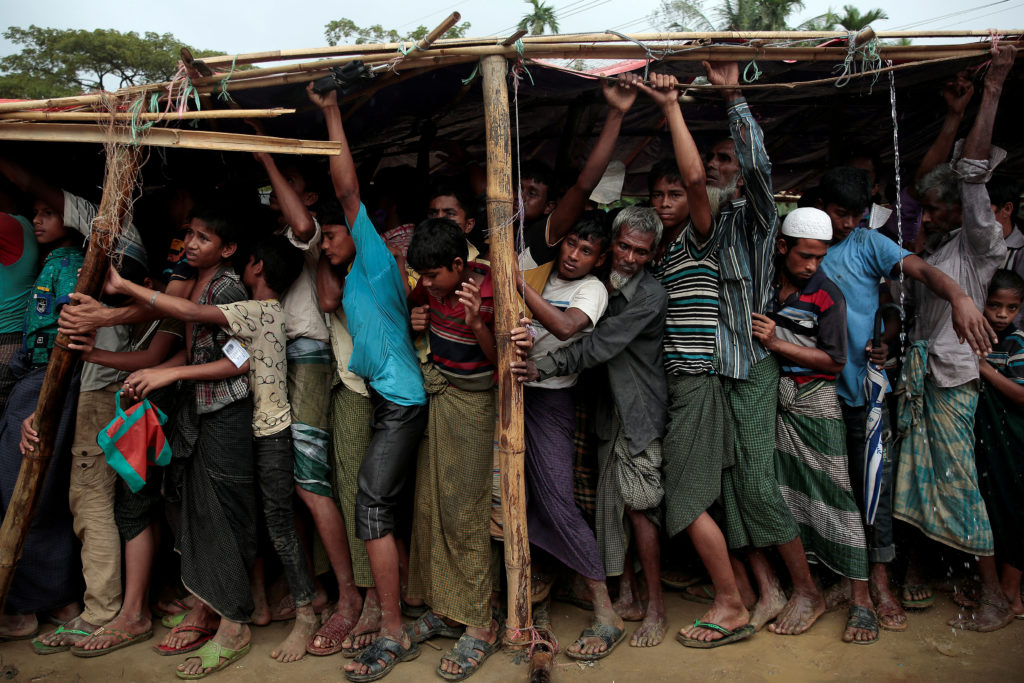 Rohingya refugees line up for a blanket giveaway under shelters while it rains at the Balukhali camp near Cox's Bazar, Bangladesh, on Dec. 11. Photo by Alkis Konstantinidis/Reuters