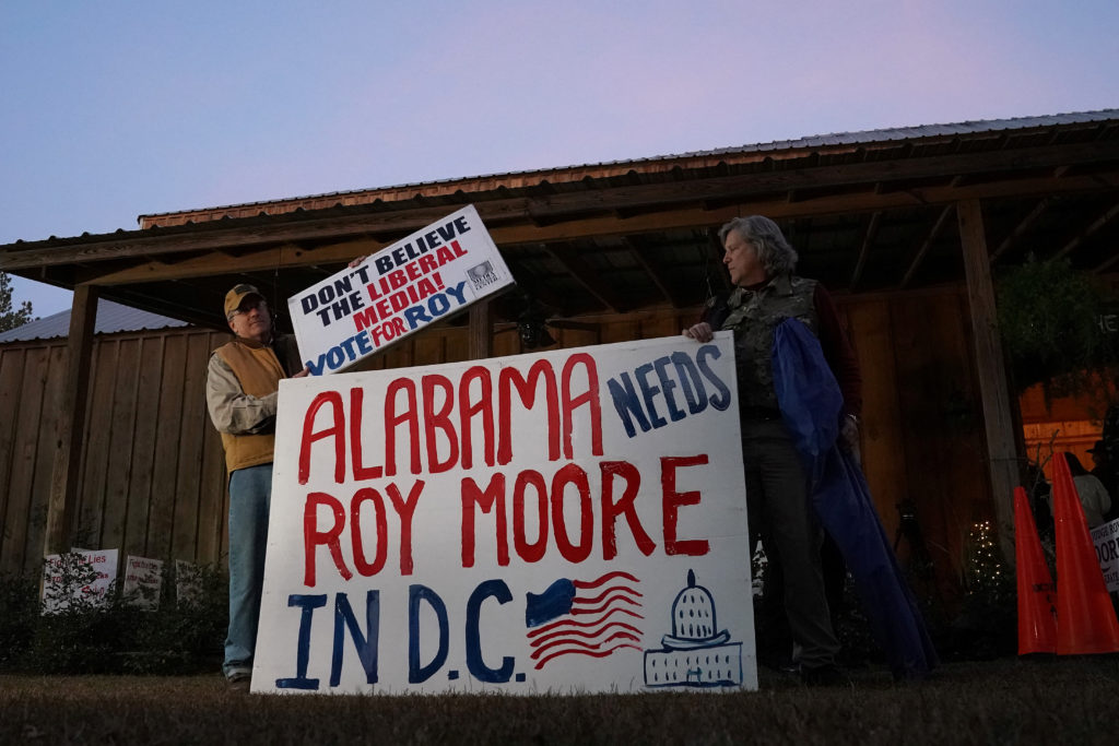 Supporters of Republican Senate candidate Roy Moore arrive for a rally in Midland City, Alabama. Photo by Carlo Allegri/Reuters