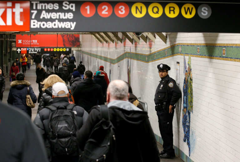 A New York City Police (NYPD) officer stands in the subway corridor, at the New York Port Authority subway station near the site of an attempted detonation the day before, in New York City, U.S. December 12, 2017. REUTERS/Brendan McDermid - RC1B6B72F9B0