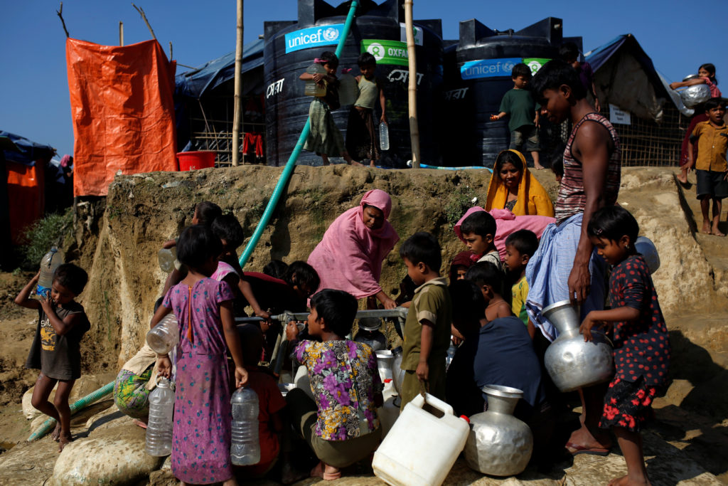 Rohingya refugees fill their containers with water at the Onchiprang refugee camp near Cox's Bazar, Bangladesh, on Dec. 13. Photo by Alkis Konstantinidis/Reuters