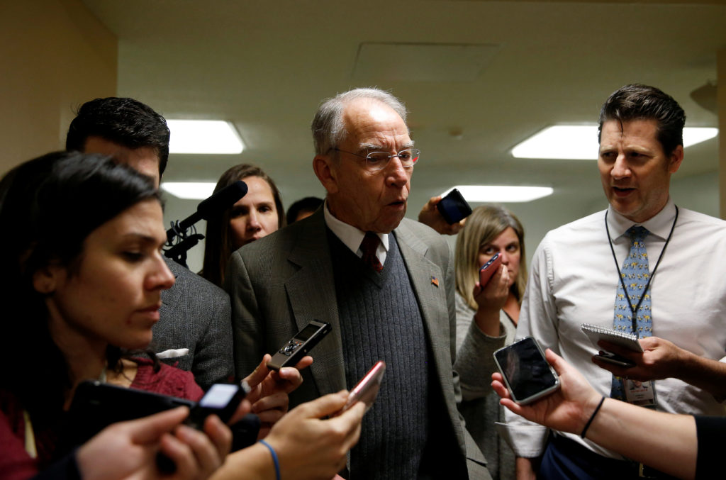 Senator Chuck Grassley (R-IA) speaks to reporters as he arrives for a nomination vote on Capitol Hill in Washington, U.S., December 13, 2017. REUTERS/Joshua Roberts