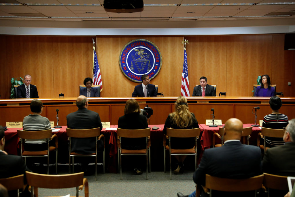 Chairman Ajit Pai leads a vote on the repeal of so called net neutrality rules at the Federal Communications Commission in Washington