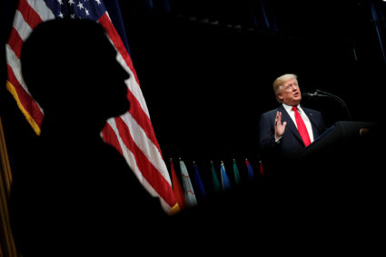 U.S. President Donald Trump delivers remarks at a graduation ceremony at the FBI Academy on the grounds of Marine Corps Base Quantico in Quantico, Virginia, U.S. December 15, 2017. REUTERS/Jonathan Ernst - RC117BF54320