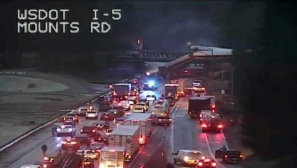 A still image from a video camera shows an Amtrak train that derailed on a bridge over a highway in Pierce County, Washington state, U.S., December 18, 2017. WASHINGTON STATE DEPARTMENT OF TRANSPORTATION/Handout via REUTERS THIS IMAGE HAS BEEN SUPPLIED BY A THIRD PARTY. MANDATORY CREDIT. NO RESALES. NO ARCHIVES - RC1B71332100