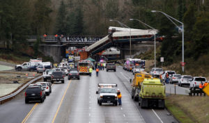 The scene where an Amtrak passenger train derailed on a bridge over interstate highway I-5 in DuPont, Washington, U.S. December 18, 2017. REUTERS/Steve Dipaola - RC114FD506E0