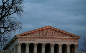 The top of U.S. Supreme Court building is lit at dusk in Washington, U.S., December 18, 2017. REUTERS/Joshua Roberts - RC13542D7C60