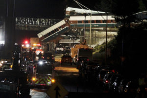 The scene where an Amtrak passenger train derailed on a bridge over interstate highway I-5 in DuPont, Washington, U.S. December 18, 2017. REUTERS/Steve Dipaola