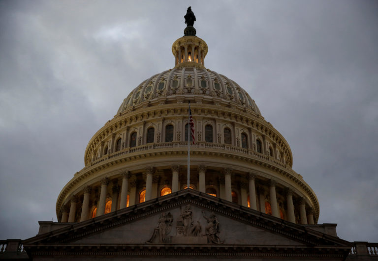 FILE PHOTO: The U.S. Capitol building is lit at dusk ahead of planned votes on tax reform in Washington, U.S., December 18, 2017. REUTERS/Joshua Roberts/File Photo - RC1ED69973F0