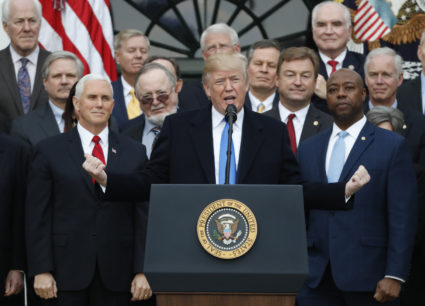 U.S. President Donald Trump speaks flanked by Vice President Mike Pence and Senator Tim Scott (R) as he celebrates with Congressional Republicans after the U.S. Congress passed sweeping tax overhaul legislation, on the South Lawn of the White House in Washington, U.S., December 20, 2017. REUTERS/Jonathan Ernst - HP1EDCK1M7E4C