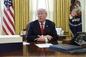 File photo of President Donald Trump in the Oval Office of the White House by Jonathan Ernst/Reuters