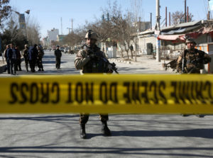 Afghan security forces keep watch at the site of a suicide attack in Kabul, Afghanistan. Photo by Omar Sobhani/Reuters