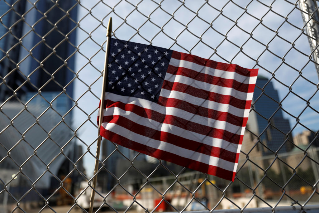 An American flag is seen left on a fence outside the National 9/11 Memorial and Museum during ceremonies marking the 16th anniversary of the September 11, 2001 attacks in New York, U.S., September 11, 2017.  REUTERS/Shannon Stapleton - RC1E86015FC0
