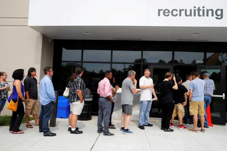 "FILE PHOTO: Job seekers line up to apply during ""Amazon Jobs Day,"" a job fair being held at 10 fulfillment centers across the United States aimed at filling more than 50,000 jobs, at the Amazon.com Fulfillment Center in Fall River, Massachusetts, U.S., August 2, 2017. REUTERS/Brian Snyder/File Photo - RC186D402B60"