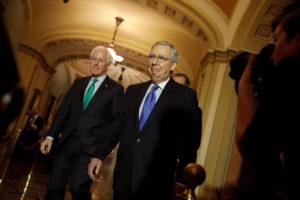 Senate Majority Leader Mitch McConnell and Sen. John Cornyn arrive to speak about the Tax Cuts and Jobs Acts at news conference following the weekly policy luncheons at the U.S. Capitol in Washington, U.S., December 19, 2017. REUTERS/Aaron P. Bernstein - RC1765E014A0