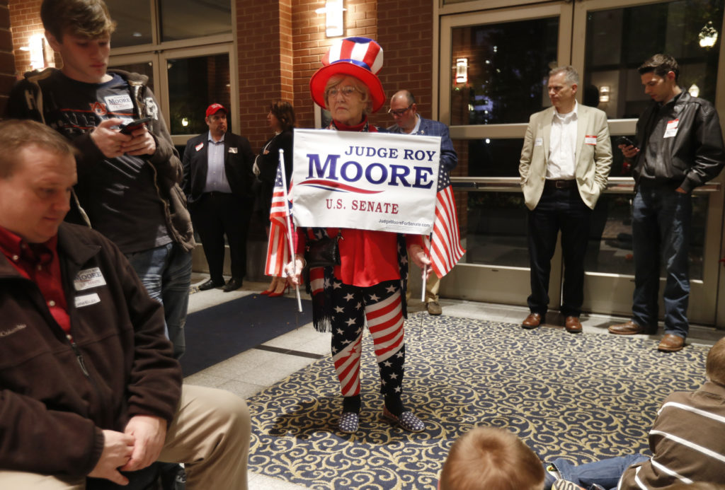 A costumed supporter waits at Republican U.S. Senate candidate Roy Moore's election night party in Montgomery, Alabama, U.S. December 12, 2017. REUTERS/Carlo Allegri - HP1EDCD050IHK