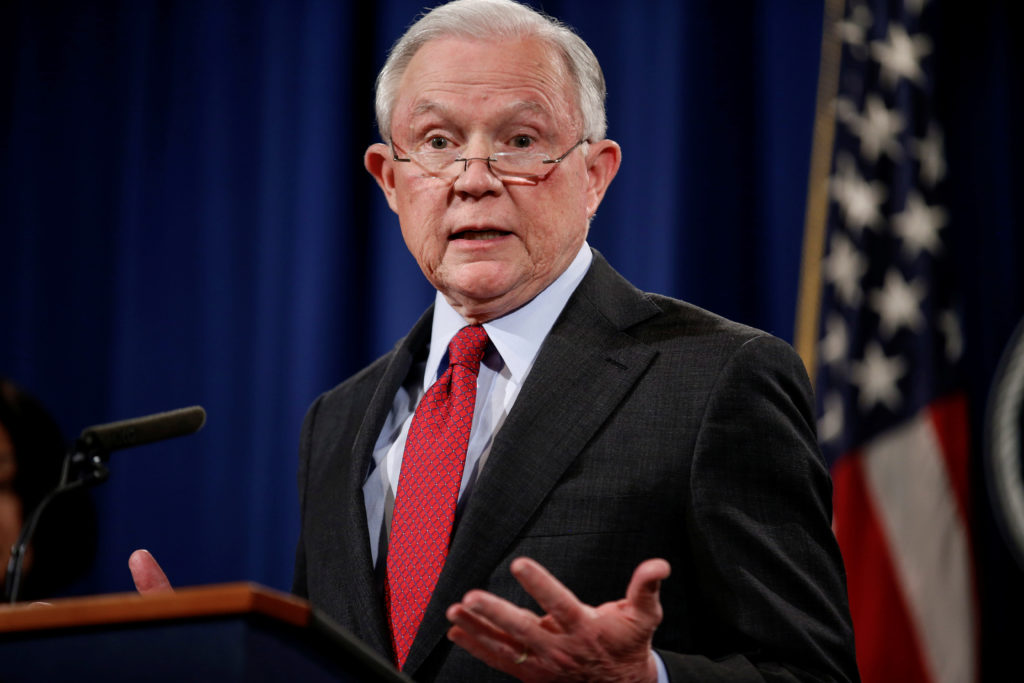 """U.S. Attorney General Jeff Sessions speaks during a news conference to discuss """"efforts to reduce violent crime"""" at the Department of Justice in Washington, U.S., December 15, 2017. REUTERS/Joshua Roberts - RC1E6A5AE6B0"""