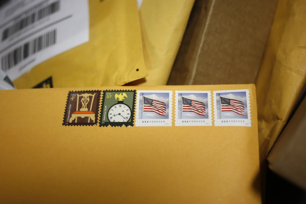 Postage stamps are seen on an envelope inside the United States Postal Service (USPS) sorting center in Louisville, Kentucky, U.S., on Friday, Jan. 13, 2017. Starting January 22, the cost of mailing a one-ounce first-class letter will return to being 49 cents, up from 47 cents, where it had been since April. Photographer: Luke Sharrett/Bloomberg via Getty Images