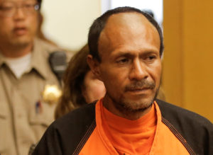 FILE PHOTO: Jose Ines Garcia Zarate, arrested in connection with the July 1, 2015, shooting of Kate Steinle on a pier in San Francisco is led into the Hall of Justice for his arraignment in San Francisco, California, U.S. on July 7, 2015. REUTERS/Michael Macor/Pool/File Photo - RC16BA9C3EC0