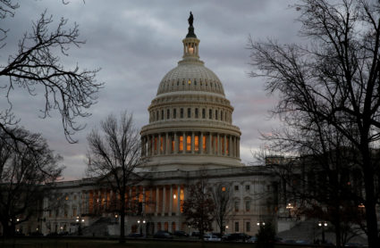 The U.S. Capitol building is lit at dusk ahead of planned votes on tax reform in Washington, U.S., December 18, 2017. REUTERS/Joshua Roberts - RC12EC274A10