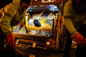 At night, private garbage collectors pick up New York City's commercial trash at often high speed and with few safeguards. Photo by Michael Santiago/ProPublica