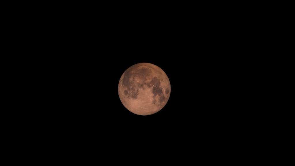 A super blood moon, colored red by stray light. Photo of NASA's Goddard Space Flight Center
