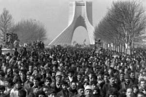 People gather at Tehran Freedom Square, formerly Monument to the Kings, to cheer the motorcade carrying Iranian opposition leader and founder of Iran's Islamic republic Ayatollah Ayatollah Ruhollah Khomeini upon his return from exile on Feb. 1, 1979 while the insurrection against the Shah's regime spreads all over the country. Photo by Gabriel Duval/AFP/Getty Images