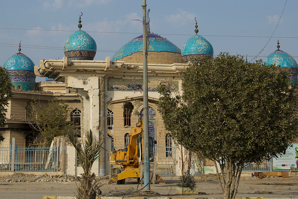 Bullets and shrapnel ripped through a mosque in the city of Fallujah. Returning Iraqis have to undertake heavy reconstruction. Photo by Noe Falk Nielsen/NurPhoto via Getty Images