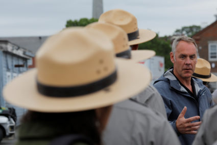 Interior Secretary Ryan Zinke (C) talks to National Park Service Rangers, while traveling for his National Monuments Review process in Boston last year. Photo by Brian Snyder/Reuters