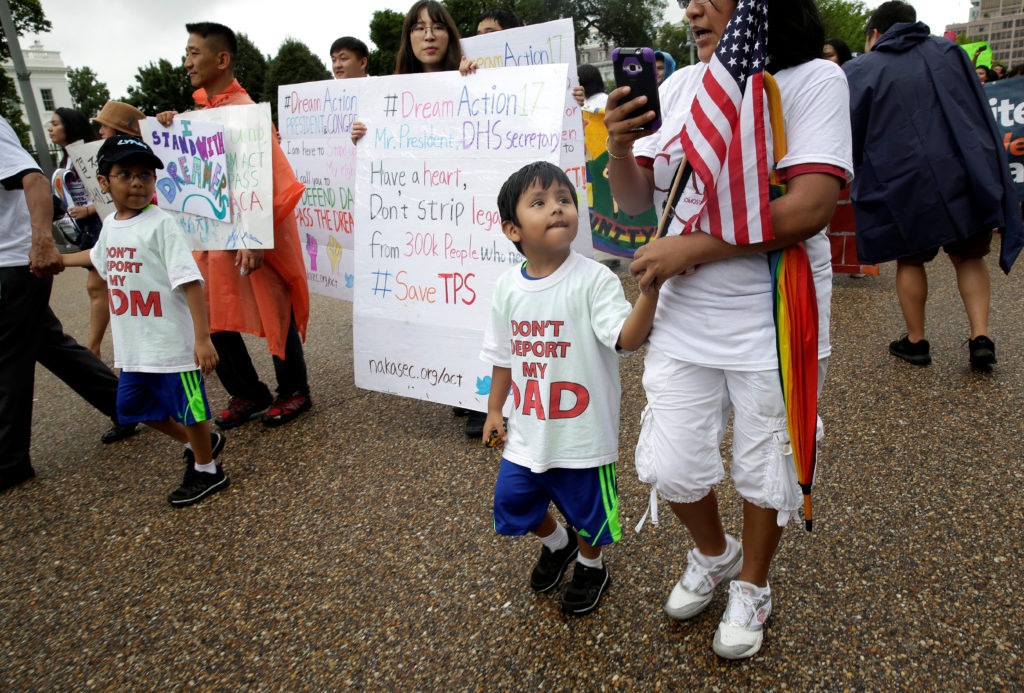 Boys wearing shirts calling for their parents not to be deported march during a rally by immigration activists CASA and United We Dream demanding the Trump administration protect the Deferred Action for Childhood Arrivals (DACA) program and the Temporary Protection Status (TPS) programs, in Washington, D.C. Photo by Joshua Roberts/Reuters