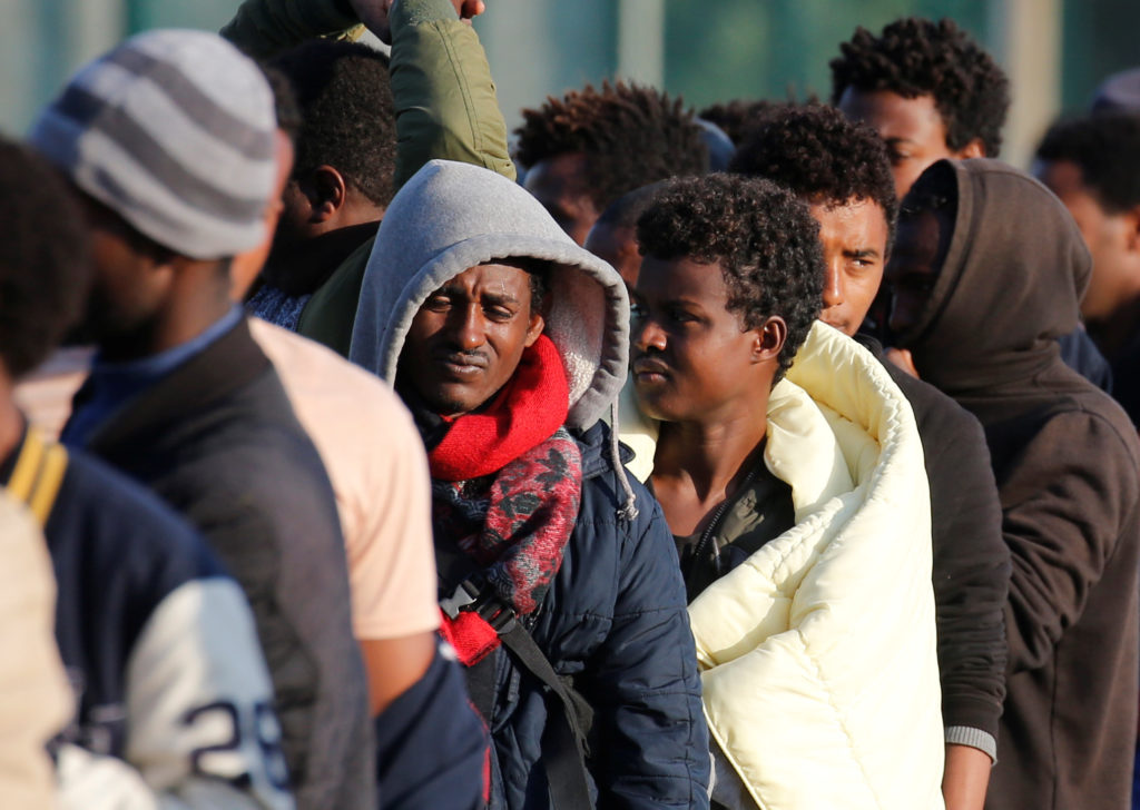Migrants from Ethiopia and Eritrea wait in line at a food distribution center in Calais, France, on Aug. 23. Photo by Pascal Rossignol/Reuters