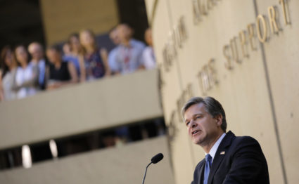 FBI Director Christopher Wray speaks to FBI employees during his installation ceremony at the agency's headquarters in Washington, D.C. Photo by Carlos Barria/Reuters