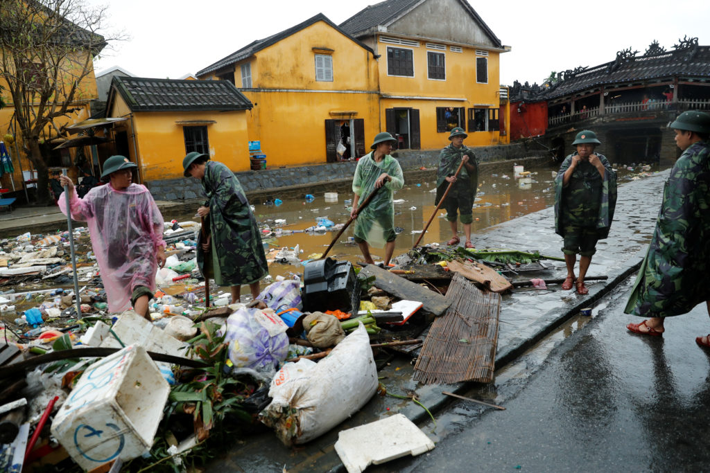 Vietnamese soldiers clean debris caused by flooding by Typhoon Damrey in the UNESCO heritage town of Hoi An on Nov. 8. Photo by Jorge Silva/Reuters