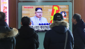 People watch a TV broadcasting a news report on North Korea's leader Kim Jong Un speaking during a New Year's Day speech, in Seoul, South Korea, in January. Yonhap via Reuters