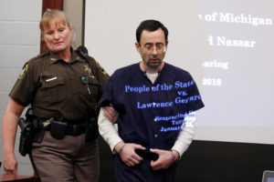FILE PHOTO: Larry Nassar, a former team USA Gymnastics doctor who pleaded guilty in November 2017 to sexual assault charges, returns from a break to listen to victim testimony in the courtroom during his sentencing hearing in Lansing, Michigan. Photo by REUTERS/Brendan McDermid/File Photo.