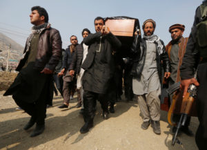 Afghan men carry the coffin of one of the victims of the Jan. 27 car bomb attack in Kabul. Photo by Omar Sobhani/Reuters