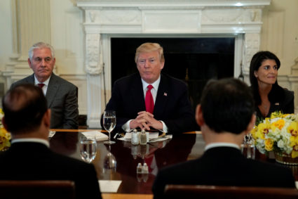U.S. President Donald Trump, seated with Secretary of State Rex Tillerson and U.S. Ambassadorto the United Nations Nikki Haley, plays host to a lunch for ambassadors to the United Nations Security Council at the White House in Washington, U.S. January 29, 2018. REUTERS/Jonathan Ernst - RC1CA4606E00