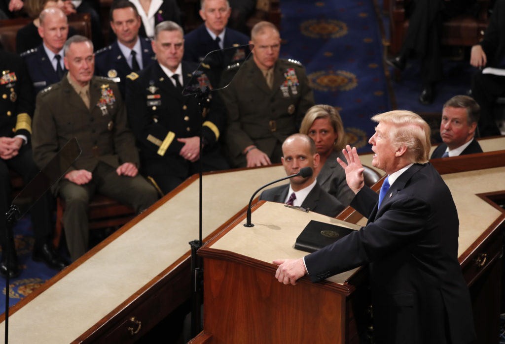 The U.S. military's Joint Chiefs of Staff listen to President Donald Trump's State of the Union address on Jan. 30. Photo ...