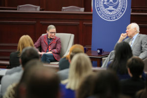"Supreme Court Justice Ruth Bader Ginsburg speaks beside Judge Bruce M. Selya, at a ""Fireside Chat"" at Roger Williams University, in Bristol, Rhode Island, Jan. 30, 2018. Photo by James Jones/Roger Williams University/via Reuters"
