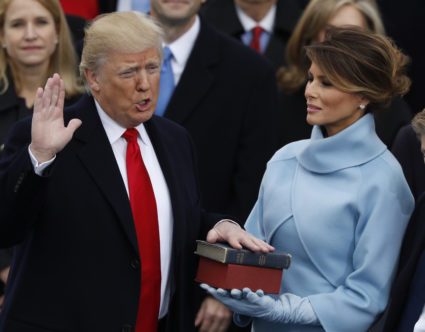 Nearly a year after his inauguration, most Americans think President Donald Trump, seen here taking the oath of office in 2017, is driving the nation apart rather than uniting it. Photo by REUTERS/Lucy Nicholson.