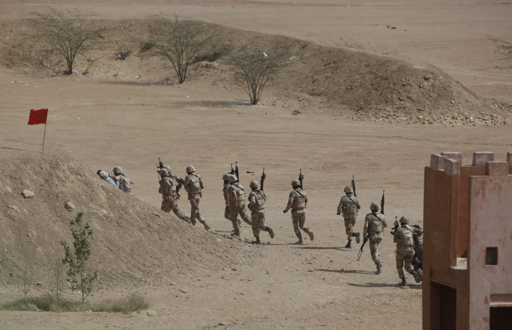 Pakistan Rangers walk with their weapons during a 2015 counter-terrorism training demonstration at the Rangers Shooting & Saddle Club (RSSC) on the outskirts of Karachi, Pakistan. Photo by Akhtar Soomro/Reuters