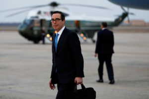 Treasury Secretary Steve Mnuchin arrives at Joint Base Andrews in Maryland, following President Donald Trump upon his return to Washington from New York in December 2017. Photo by Yuri Gripas/Reuters