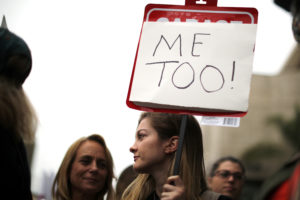 "FILE PHOTO: People participate in a ""MeToo"" protest march for survivors of sexual assault and their supporters in Hollywood, Los Angeles, California, U.S. on November 12, 2017. REUTERS/Lucy Nicholson/File Photo - RC1C889713F0"